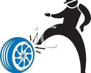 Man Kicking Tires