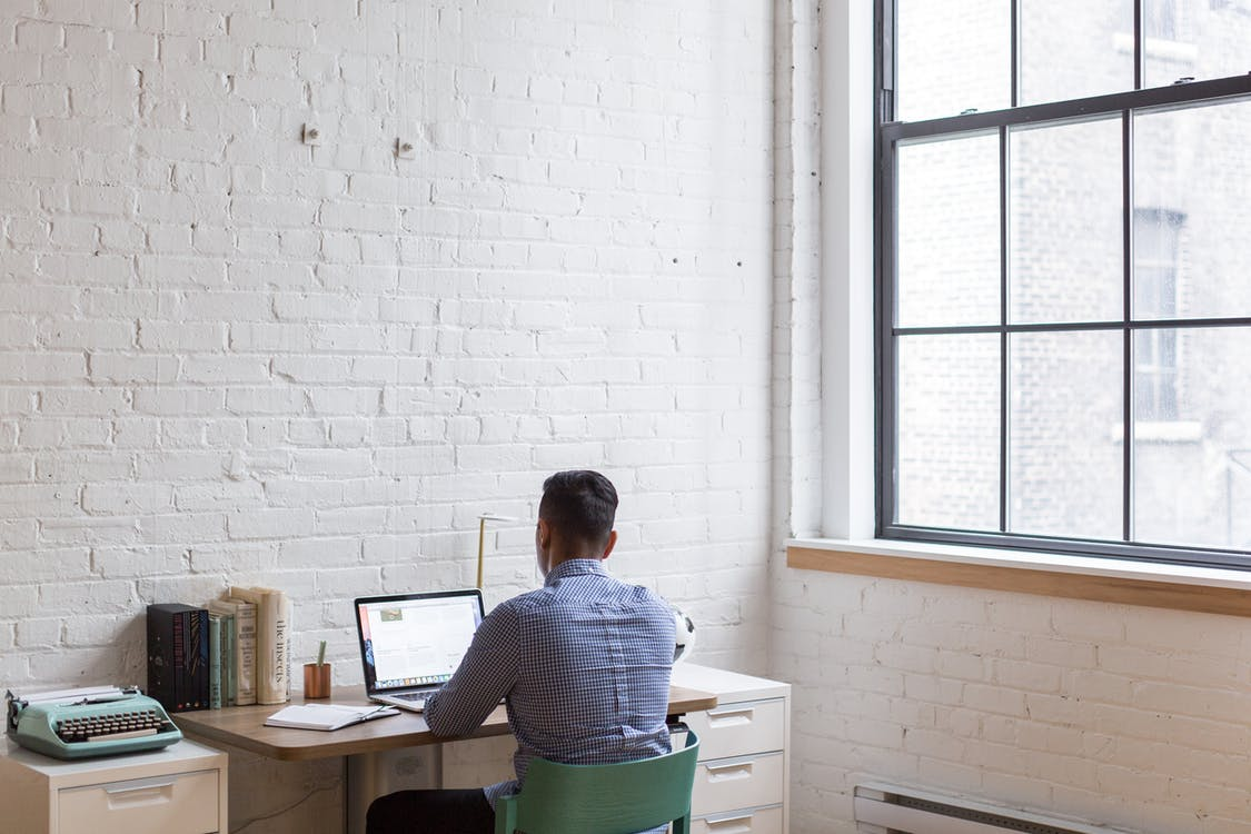 man using laptop in the office