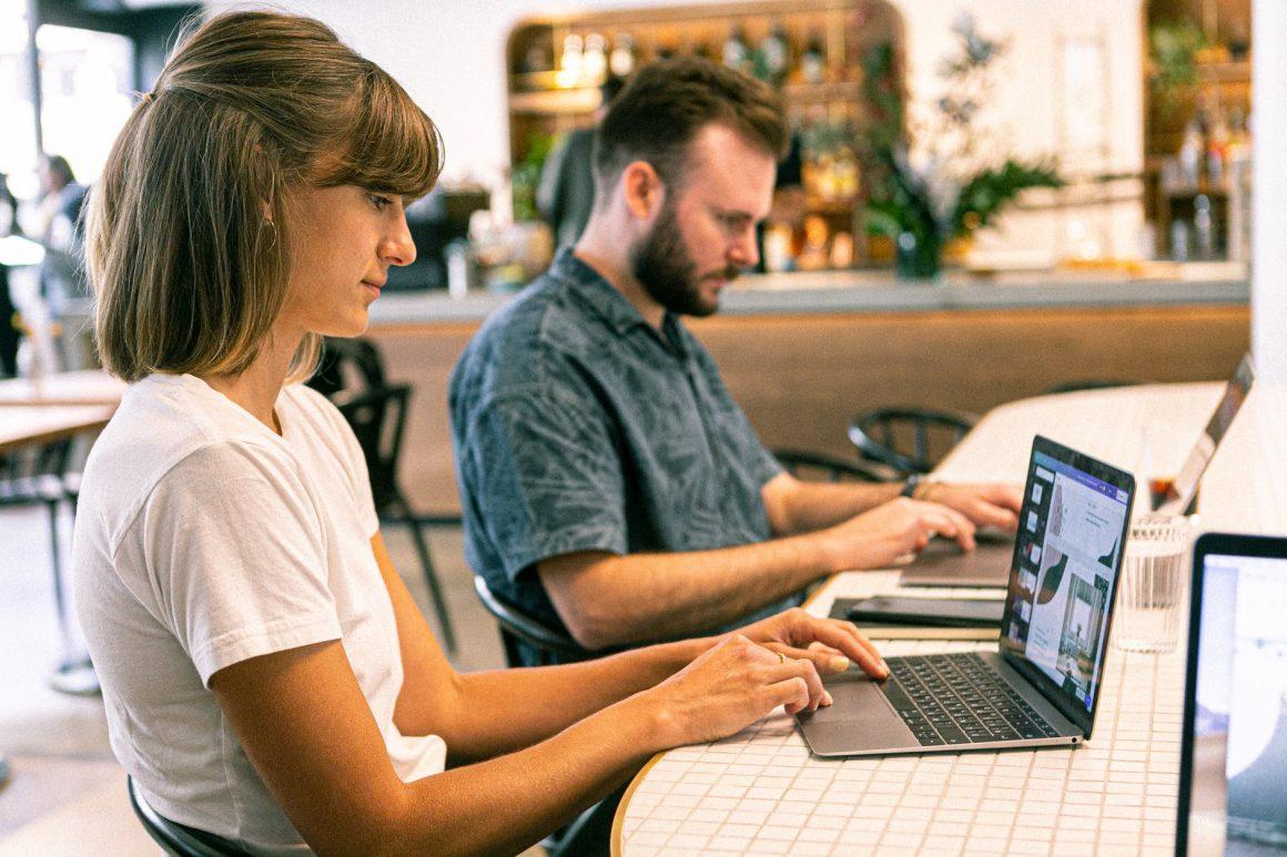 associates working on their laptops