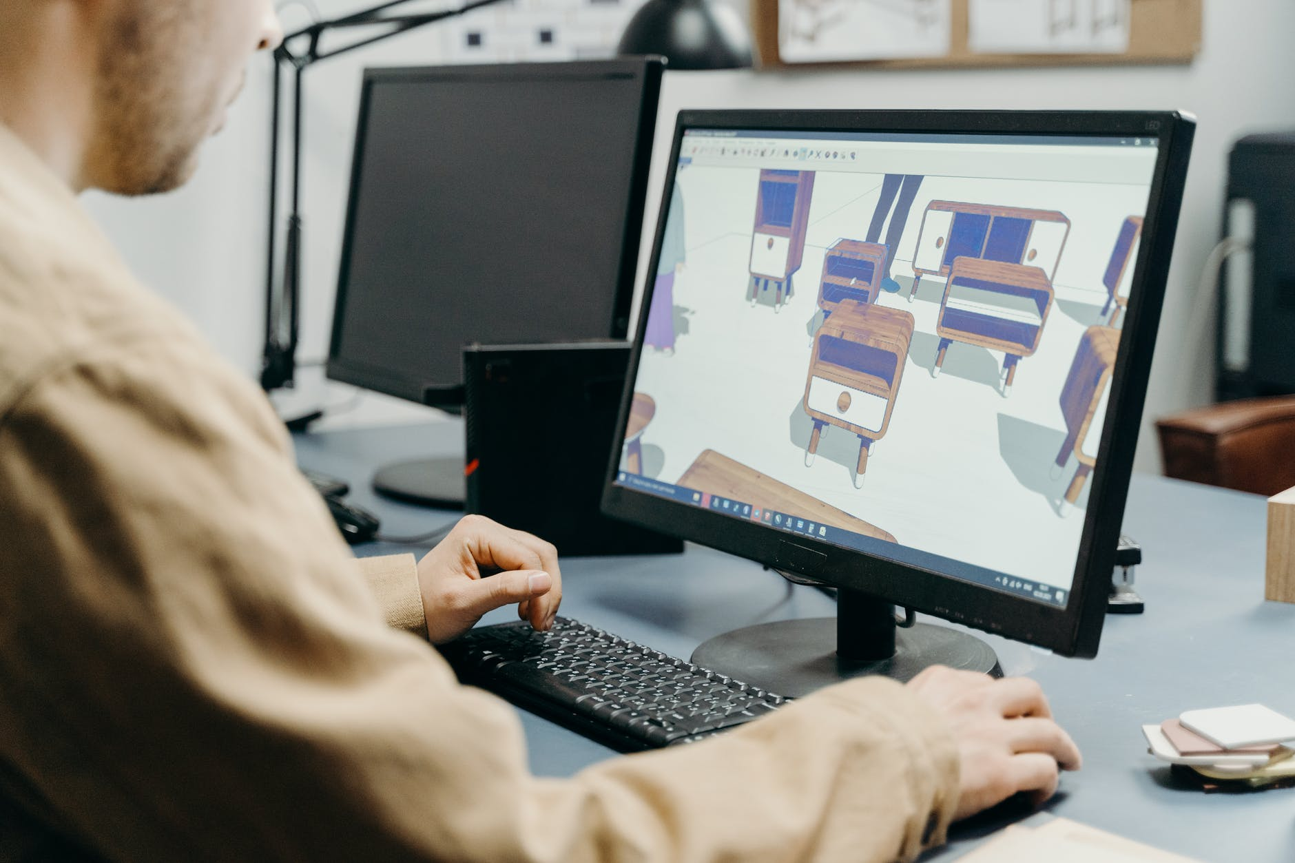 a man in front of a computer