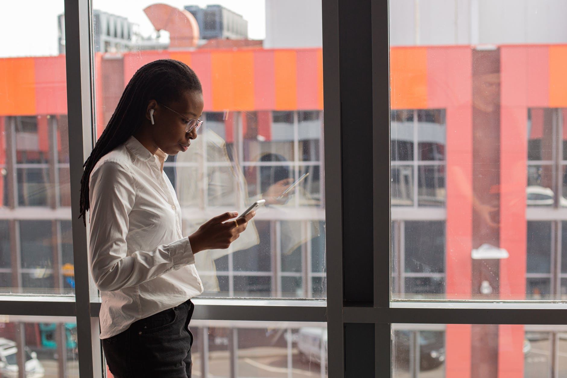 a lady reading thru her phone
