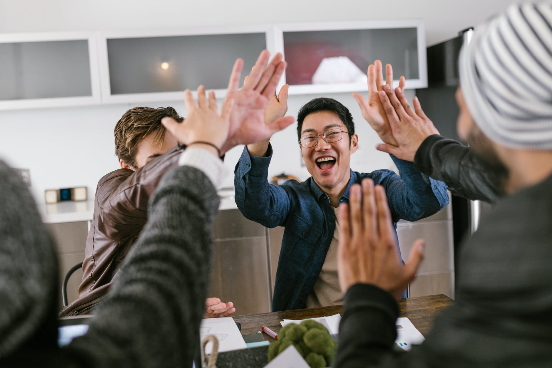happy employees having high fives